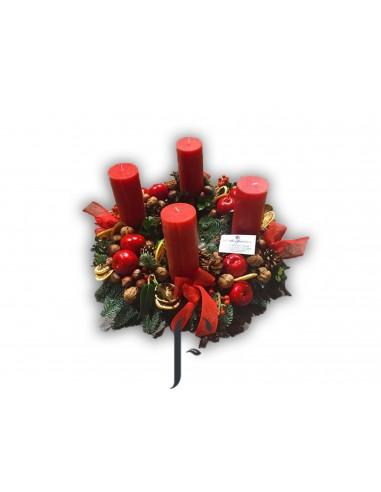 Centro Navidad con 4 velones rojos.